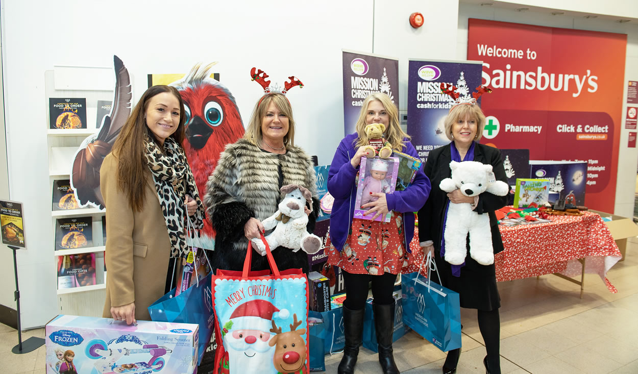 Ladies holding donated gifts at Meridian Waterside Southampton